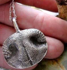 I may have to do this someday. Imprint your dog's nose or paw print into a necklace... I love this! I'd stick with a paw print. Dick would never forgive me for smashing his nose in some clay.
