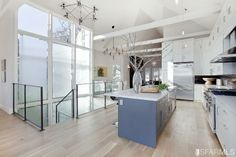 Spacious and light-filled kitchen. We could take advantage of the existing A-Frame to have a similar cathedral ceiling. Could also have similar frosted glass to east-facing light well.