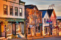 The golden warmth of sunrise touches some of the buildings on Main Street in Bar Harbor, Maine, host of Acadia National Park. - photo by Greg A. Hartford