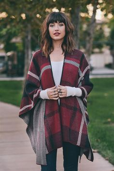 We can't get over this pretty plaid poncho in burgundy! It features a super soft…