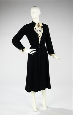 """Ensemble House of Chanel  (French, founded 1913) Designer: Gabrielle """"Coco"""" Chanel (French, Saumur 1883–1971 Paris) Date: ca. 1956 Culture: French Medium: silk, wool, leather Dimensions: Length at CB (a): 48 in. (121.9 cm) Length at CB (c): 48 in. (121.9 cm) Credit Line: Brooklyn Museum Costume Collection at The Metropolitan Museum of Art, Gift of the Brooklyn Museum, 2009; Gift of H. Gregory Thomas, 1959 Accession Number: 2009.300.261a–c Ensemble"""