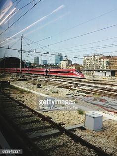 Foto stock : High Speed Train On Railroad Track Against Sky Seen Through Glass Window