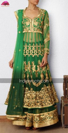 Green net anarkali lehenga with 30 kalis and heavy gold embroidery by Sanskriti on Indianroots.com