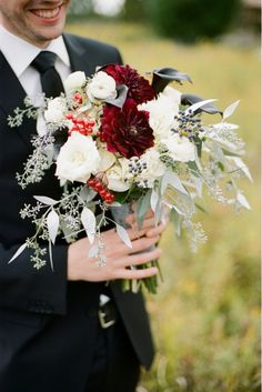 red and white bouquet with dahlias, roses, calla lilies, berries and eucalyptus | photo: emilysteffen.com | floral design: Camrose Hill