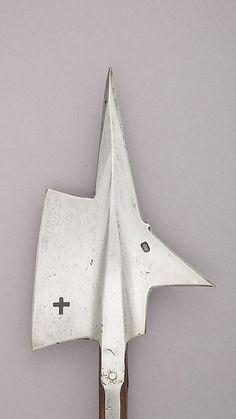 Halberd Date: late 15th century Culture: Swiss Medium: Steel, wood Dimensions: L. 72 in. (182.9 cm); L. of head 12 15/16 in. (32.9 cm); W. 8 1/4 in. (21 cm); Wt. 4 lbs. 13.6 oz. (2199.9 g)