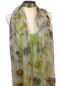 """This one of a kind Silk Chiffon scarf, is hand made by me in a process referred to as """"Eco Printing"""", with colors extracted from leaves, flowers, fruits, roots and tree barks, using types of plants locally found in Israel according to seasons.This scarf is a perfect accessory for Spring & Summer / Autumn seasons, the fabric is super soft, large enough to be worn as a shawl over an evening dress / day wear and light enough to scrunch into a comforting scarf.This floral shawl is a unique and…"""