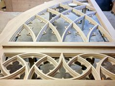 As seen in the shop, the side arch tracery is a reduced, half-version of the main arch designed to fit within buttresses on a side aisle. Gothic Windows, Church Windows, Curved Wood, Gothic Architecture, Quatrefoil, Door Design, Cathedral, Woodworking, Carving