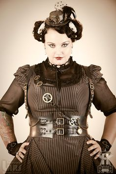 """Leather instead of rubber but harness type """"vest""""?  Steampunk harness in recycle rubber. $125.00, via Etsy."""