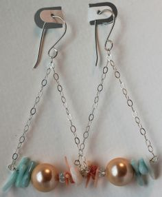 item #E050-S4 The perfect combination of -sweet & salty- these earrings are made with peach coral branches, pearls and mother of pearl that are sweet & oahu pukas that are salty- suspended on sterling silver chain.  (measuring 3 in by 1 in)