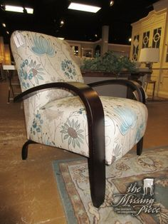 """Best Chair Co. accent chair in a blue and tan floral patterned upholstery on dark legs with large dark arms. This chair has such a great profile; love the shape! 32""""wide x 35""""deep x 39""""high."""