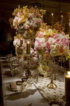 elegant centerpieces, onyl if i had a 100,000 laying around to spend on wedding