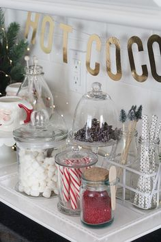 It's the most wonderful time of the year! Take your next holiday gathering up a notch with a hot cocoa bar. Here are some cute ideas to make a hot cocoa bar — and one your guests will love. Christmas Room, Cozy Christmas, Rustic Christmas, Beautiful Christmas, Christmas Holidays, Christmas Kitchen Decorations, Tacky Christmas Party, Apartment Christmas, Christmas Mantels