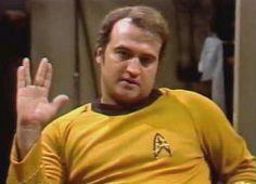 "John Belushi signing off as Captain Kirk in Saturday Night Live's skit ""The Last Voyage Of The Starship Enterprise"", May 29, 1976."