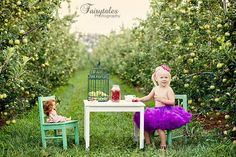 I know im going to take a million pictures of my kids haha, i love that shes only got a tut on for her tea party! so cute