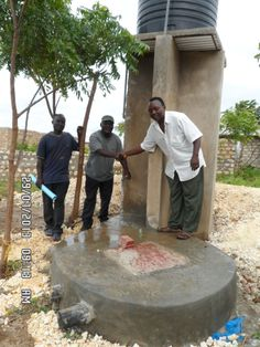Handing the newly finished well to the leaders of the village. AMEN