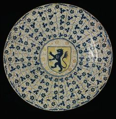 Dish with coat of arms, tin-glazed earthenware with lustre and cobalt decoration, made in Manises, Spain, 1430-70