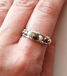 Check out this item in my Etsy shop https://www.etsy.com/listing/71189168/valhalla-collection-ring-silver-pyrite