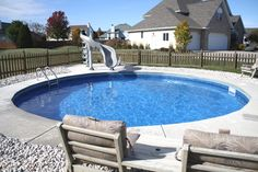 freedom above ground pool installed inground with concrete deck and slide