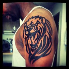 Awesome tribal lion arm tattoo for men cool tattoo designs tatts tattoo Lion Arm Tattoo, Tribal Lion Tattoo, Cool Tribal Tattoos, Lion Tattoo Design, Badass Tattoos, Lion Design, Engel Tattoos, Leo Tattoos, Celtic Tattoos