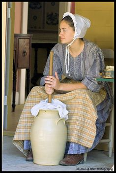 This is an Amish lady, we are not Amish. But Mema churned some butter, so sad what kids are missing out on today. Oh well, she would let us churn, but not get the butter out!!  Her solid round block of butter always had a palm tree on top, too cool.