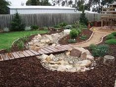 Image result for dry creek ideas for your under a gate