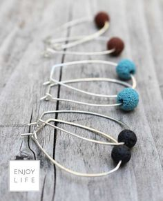ENJOY LIFE diffuser jewelry collection. 2GETHER Silver Hand Forged Hoop Diffuser Earrings with Lava Bead, comes in black, brown and turquoise. Aromatheraphy earrings - can be used with yoru favorite essential oils.