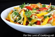 ASIAN CABBAGE MANGO SLAW  Yield: 6Prep Time: 15 min.Total Time: 15 min.  INGREDIENTS:  3 tbsp rice vinegar  1/2 a lime, juiced  1 tbsp soy sauce  1 tbsp sesame oil  2 cups of green cabbage,shredded  1/2 cup of shredded carrots  1/4 cup of fresh cilantro, chopped  2 green onions, chopped  1 baby red bell pepper, sliced  1 mango, nearly ripe, sliced  Sesame seeds, to taste