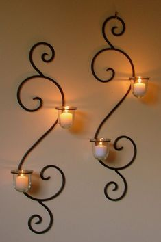 Wall Mounted Long Holder Using Wrought Iron Candle Holders As Decorative Items