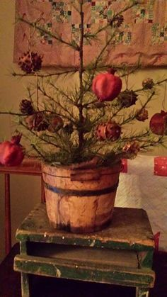 Old Bucket...filled with dried pomegranates on a prim Christmas Tree.