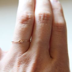 One Tiny Memory Knot - Knotted Thread of Rose Gold Ring - Stacking Ring - Delicate Jewelry - Memory Ring. $9.75, via Etsy.