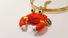 Ehi, ho trovato questa fantastica inserzione di Etsy su https://www.etsy.com/it/listing/543101290/bracciale-charms-granchio-arancione-con