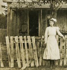 1900  Young woman at the fence