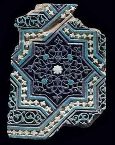A TIMURID MOULDED POTTERY TILE PANEL CENTRAL ASIA, LATE 14TH/EARLY 15TH CENTURY
