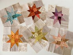 Love the contrast and use of different tone on tone fabrics around the stars. By Patchwork Pottery.