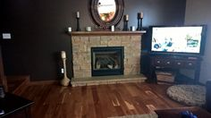 Stone Gas Fireplace. Wood Floor. Mantle.