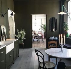 Oh my days. Just look at this kitchen dining area. Marble table with the green touches of black and then a formal dining area with those pink chairs. I need to pick myself off the floor. Ellen Svensson #green #khaki #khakigreen #olive #olivegreen #thursday #thursdayinspiration #midcenturymodern #midcentury #midcenturyliving #midcenturystyling #interiordesign #interiors #interiorstyle #interiorstyling #interiorinspo #homedecor #homestyle #homedesign #homestyling #interiorsblogger #inter...