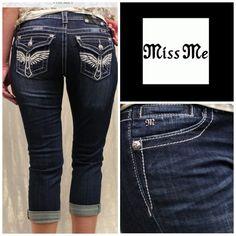 "Miss Me Boyfriend Capri Miss Me Cross Wings Boyfriend Capri.  JB5117P29.  98% cotton, 2% elastane.  Five pockets, belt loops, zip fly, leather and crystal embellishments on back pockets.  Approx waist 17-1/2"",  inseam 26"",  10"" rise.  Dark wash.   (1) Miss Me Jeans"