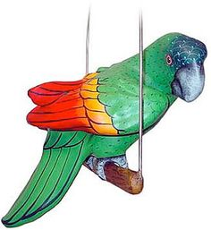 This beautiful paper mache parrot was hand-formed and hand-painted in the small studio of Arte Mundo Pequeno.  A colorful addition to any decor, this exquisite paper mache artwork is perfect for brightening up any room.  Makes a wonderful Christmas, anniversary or birthday gift, too.