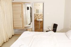 The rooms are elegantly furnished with attached  bathrooms and modern amenities.