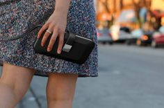 The Everpurse mini has an aluminum charging dock on the exterior to fit the phone.