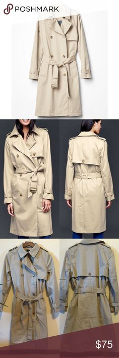 """Gap Trench Coat Long ESSENTIAL TRENCH * 100% Cotton. * Machine Washable  * Smooth twill weave outer, chambray body lining, twill sleeve lining. * Long sleeves with button-tab cuffs. * Collar, hook & bar closure at collar stand. * Double-breasted button front. * Storm flap at front and back. * Tie belt with metal buckle at waist. * Angled welt pockets. * Rear vent.   Really nice trench coat, nice heavy material, hangs beautifully. Oak color. Length 31"""" (armpit to hem) Sleeve 17.5""""…"""