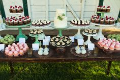 cupcake table with a small wedding cake. Could do red velvet cup cakes with white cream cheese frosting??