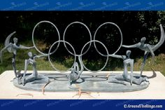 """""""Olympic Alegory,"""" donated by the Hungarian Olympic Committee in 2005 to the IOA. The sculptor was Ferenc Nemeth. Olympic Committee, Olympic Games, Olympia, Photo Galleries, Sculptures, Ceiling Lights, Running, Gallery, Roof Rack"""