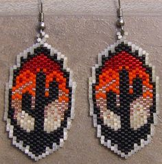 These pretty earrings are done with size11 delcia seed beads. They measure 2 long. These earrings are made by my hands. The designer of these earrings is Star Design. Thank you for looking at my bead work. Life is better than good.