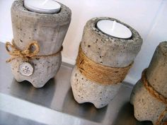 concrete votive holder -- looks like it's made from the bottom half of a plastic soda bottle interieur cement Steps On How To Make Concrete Candle Holders Cement Art, Cement Planters, Concrete Cement, Concrete Furniture, Concrete Crafts, Concrete Projects, Concrete Design, Recycled Furniture, Furniture Ideas