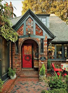 "The owner of Standard Brick & Tile in Portland, Oregon, created a media blitz after he commissioned this ""English Cottage"" as a model home in the Laurelhurst neighborhood. A Tudor house blends vintage charm and cozy furnishings. Style Cottage, Cute Cottage, Cottage Homes, Brick Cottage, Tudor Cottage, English Cottage Exterior, Tudor House Exterior, English Tudor Homes, Log Homes Exterior"