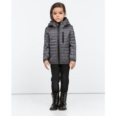 Keep kids warm and dry wearing Gerry, a compact transitional jacket that segues effortlessly between seasons. Filled with lightweight down and feathers, its water resistant nylon shell is trimmed with RUDSAK's luxe leather signature trims. Designed to be adjustable, it features removable sleeves for wear as a vest and a hood that can be tightened for better coverage.