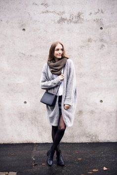 The oversized cardigan trend looks best worn with a dress or skirt, as seen here worn by Anna. We also love this cute knitted snood. Cardigan: H&M, Shirt: Cos, Skirt: H&M, Bag: Mango, Shoes: Holly's.