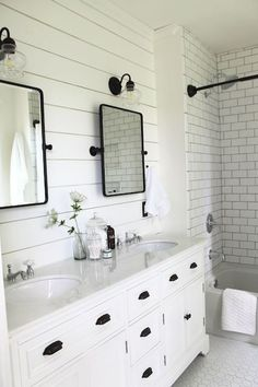 Beyond the shiplap walls, the small touches, like the matte black hardware and porcelain cross handles, add to the farmhouse feel of this bathroom remodel. Bathroom Renos, Bathroom Renovations, Home Remodeling, Bathroom Ideas, Remodel Bathroom, Bathroom Bin, Shiplap Bathroom Wall, Gold Bathroom, Bathroom Vanity Lighting