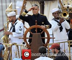 Robbie Williams - Robbie Williams filming a music video for his song 'Go Gentle' off his upcoming album 'Swings Both Ways' in downtown Los Angeles. The English singer-songwriter was seen on top of a pirate ship wearing an old captain's suit - Los Angeles, CA, United States -4/10/2013